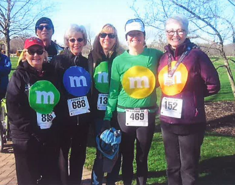 For the third year, 20-year Food Bank volunteer Vi Nelson (third from the left) participated in the Food Bank's annual Foodie 5K in Wheaton on April 1, 2017 along with her daughter (middle) and other members of the Monday Morning (M&Ms) volunteer group.