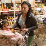 mom and girl in cart